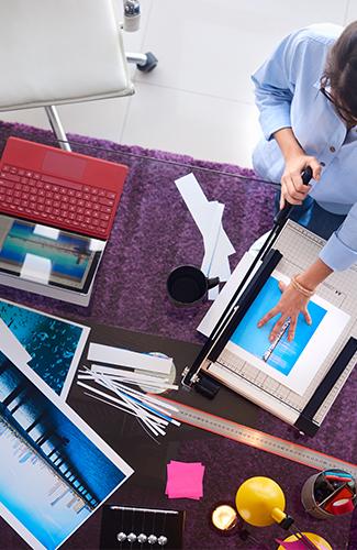 Photographer-Cutting-Print-In-Studio-Image